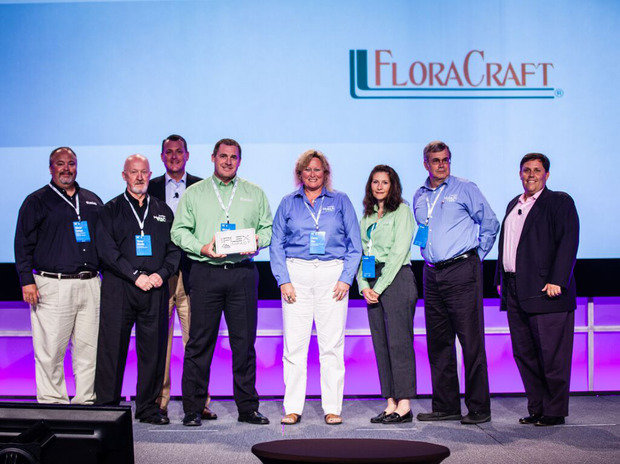 FloraCraft accepts the Plex Systems 2015 Plex Impact Award for Innovation at PowerPlex 2015.